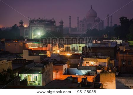 In the shadow of the endless beauty of Taj Mahal.