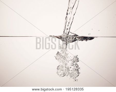 Jet splashing into water surface view