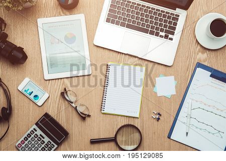 Business graph analysis report. Accounting.  Financial concept. business earning report and financial chart and graph report on desk.
