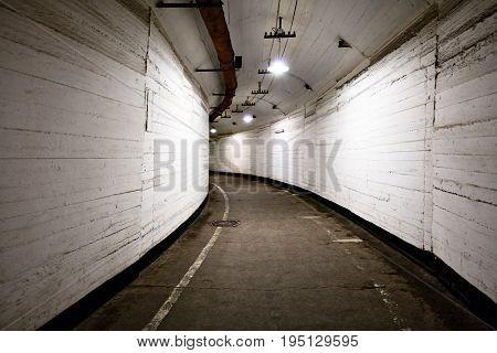 Underground  tunnel corridor with bright lighting lamp