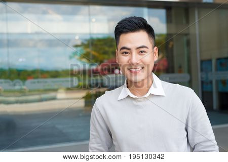 Portrait Of An Handsome Confident Asian Man Outside Buidling.