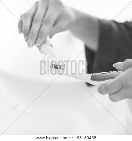 Closeup On Young Woman Squeezing Toothpaste On Toothbrush