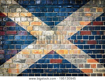 Scottish flag on a brick wall background