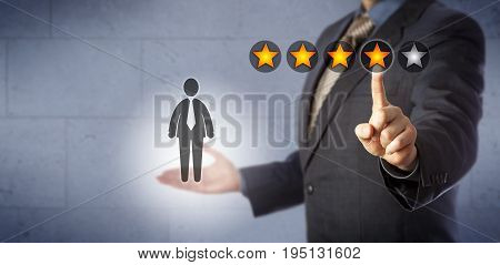Blue chip human resources manager is giving a male employee a four star rating out of five. Business concept for performance review and monitoring talent management career development discussion.