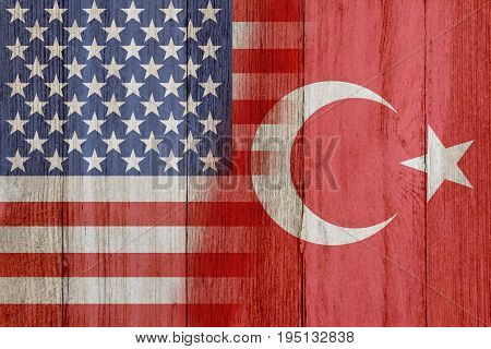 Relationship between the USA and Turkey The flags of USA and Turkey merged on weathered wood