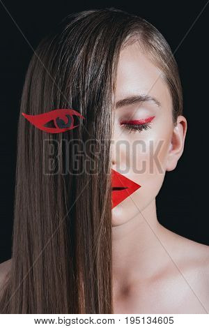Obscured View Of Woman With Long Hair And Bright Paper Makeup Posing For Fashion Shoot Isolated On B
