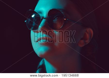 Headshot Of Young Smiling Woman In Sunglasses Looking Away