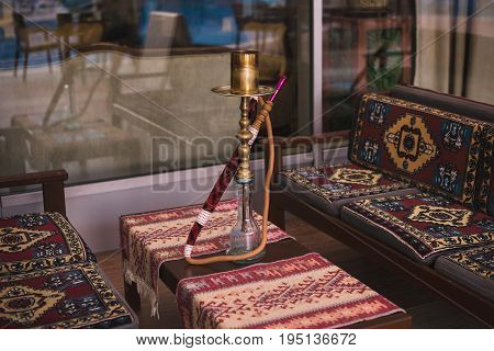 Hookah On The Table At An Outdoor Cafe Decorated In Oriental Style