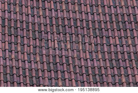 Old terracotta tile with gutter roof laid in rows texture pattern urban theme