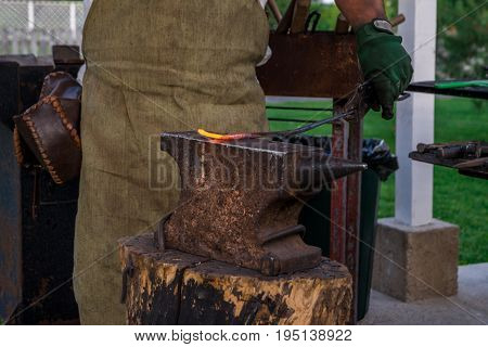 The Smith Holds A Metal Bar Heated To Melting On The Anvil, Before Hammering. Retro Work., Craft. Ho