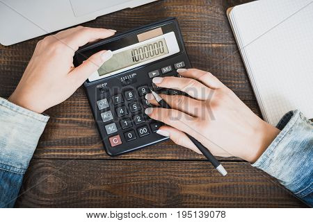 Morning Business Lady. Female Hands With A Pen And A Calculator, On Which A Million Is Counted. Hori