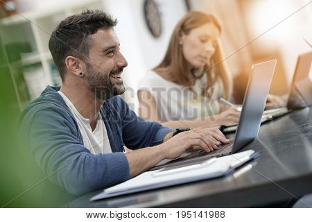 Trendy young people working in co-working office