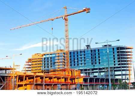 Construction with a crane, a tower crane on the construction of a building