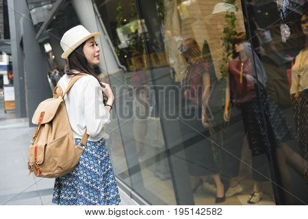 Woman Tourist Walking In Shopping Streets