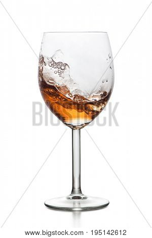 Splashing drink in glass isolated on white background