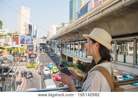 Traveler Woman Using Tablet On Flyover
