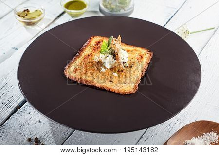 Restaurant Cold Starter Food - Vegetable Soup Bowl. Gourmet Restaurant Soup Menu. Vegetable Soup Topped with Toast