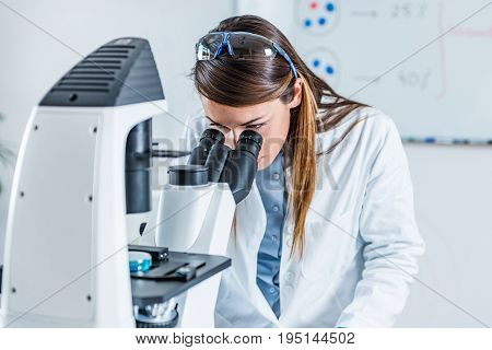 Researcher In Laboratory, One Woman Only, Toned Image