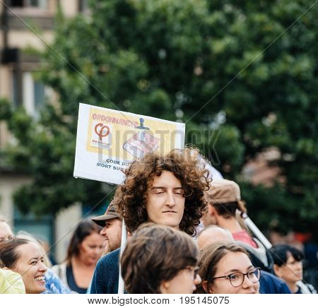 STRASBOURG FRANCE - JUL 12 2017: Man at protest as Melenchon called for day of protest against Macron government spending cuts and pro-business tax and labor reforms