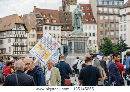 STRASBOURG FRANCE - JUL 12 2017: Group of protesters in city as Melenchon called for day of protest against Macron government spending cuts and pro-business tax and labor reforms