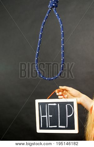 Woman Hand Holding Help Sign Next To Rope
