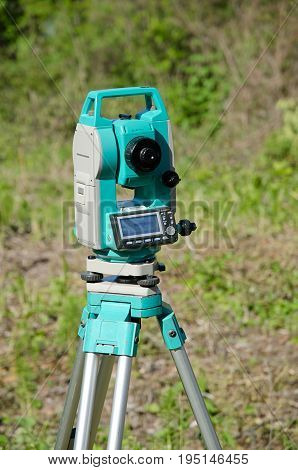 Modern surveyor equipment, theodolite or tacheometer used in surveying and building construction for precise measurement.
