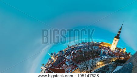 Tallinn, Estonia. Traditional Ancient Architecture Of Old Town Cityscape In Historic District. Winter Evening Or Night Illumination. Famous Landmarks In Funny Panorama Like Half Part Of Little Planet