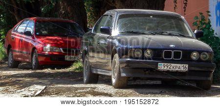 Kazakhstan, Ust-Kamenogorsk, july 5, 2017: Bmw E34 5-series and Toyota Carina E