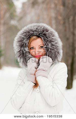 Pretty caucasian woman in a winter park
