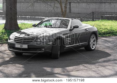 MOSEL GERMANY - MARCH 26 2016: Chrysler Crossfire Roadster in a parking lot in Germany on the Mosel.