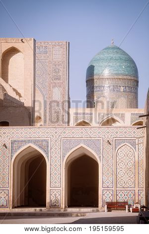 Color image with a madrasa and a dome in Bukhara Uzbekistan.