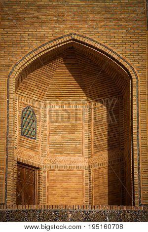 Color image with a madrasa detail in Bukhara Uzbekistan.