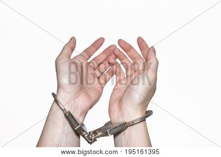 Close up hands with silver handcuffs isolated on white background