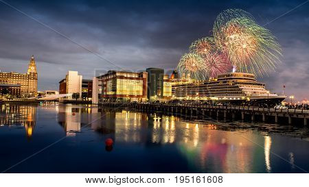 Liverpool: JULY 11th 2017 - Fireworks erupt over the Cunard cruise liner Queen Elizabeth in Liverpool
