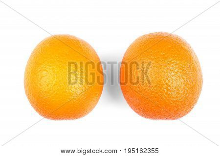 Close-up of two juicy and ripe sweet oranges. Ripe citrus fruits. Fresh, tasty, sweet, ripe, juicy and bright oranges, isolated on a white background, top view.