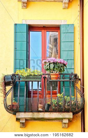 A window from the city of Venice Italy with decorations.