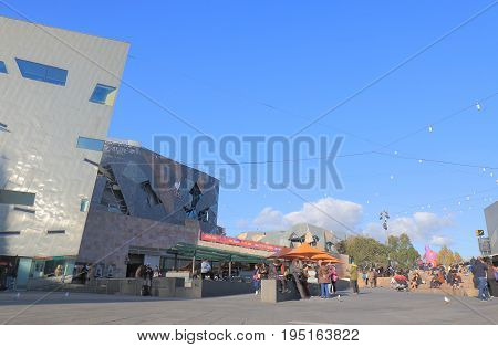 MELBOURNE AUSTRALIA - JUNE 30, 2017: Unidentified people visit Federation Square in Melbourne.