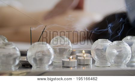 Medical glass cups in the massage room on the background of physiotherapy, Tibetan medicine