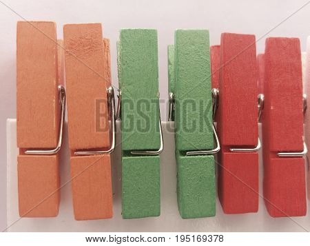 Clothes pegs 2. Three pairs of wooden clothes pegs in different pastel colors