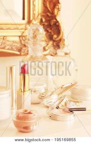 Closeup of lipstick and other cosmetics on the table