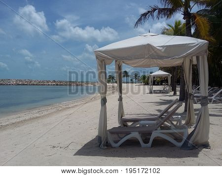 Chairs with shade on a beautiful beach of campeche