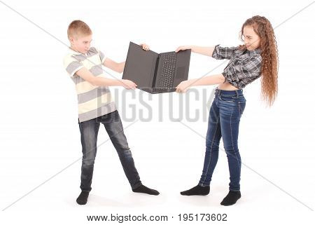 Boy and girl fighting over a laptop isolated on white