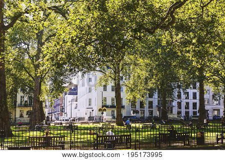 LONDON UNITED KINGDOM - August 12th 2016: Detail of Berkeley Square Gardens and its buildings architecture in London city centre