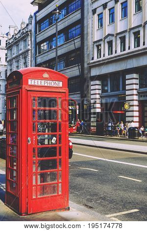 LONDON UNITED KINGDOM - August 6th 2016: Detail of red phone booth in the street of London city centre and the beautiful architecture in Piccadilly