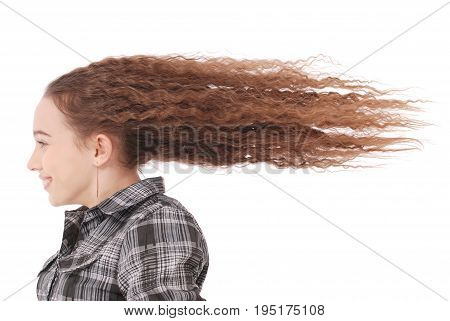 Girl in the Wind. Portrait girl whose hair is flying in the wind isolated on white