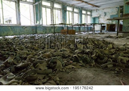 Gas masks cover the floor of an abandoned building in Chernobyl after the nuclear catastrophe