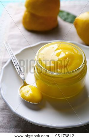 Beautiful composition with delicious lemon curd on table