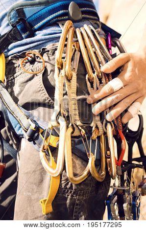 Climber with Carabiners Around Waist