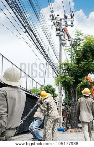 Electricity installation and electrical maintenance services on aerial and bucket truck equipment for high reach. High-risk occupation.