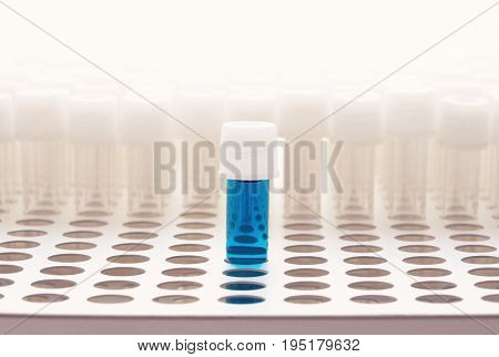 Blue test tube with empty test tubes